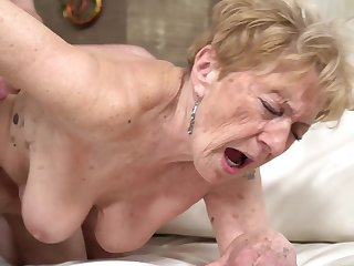 A hellacious old granny is getting fucked in her pussy doggy style